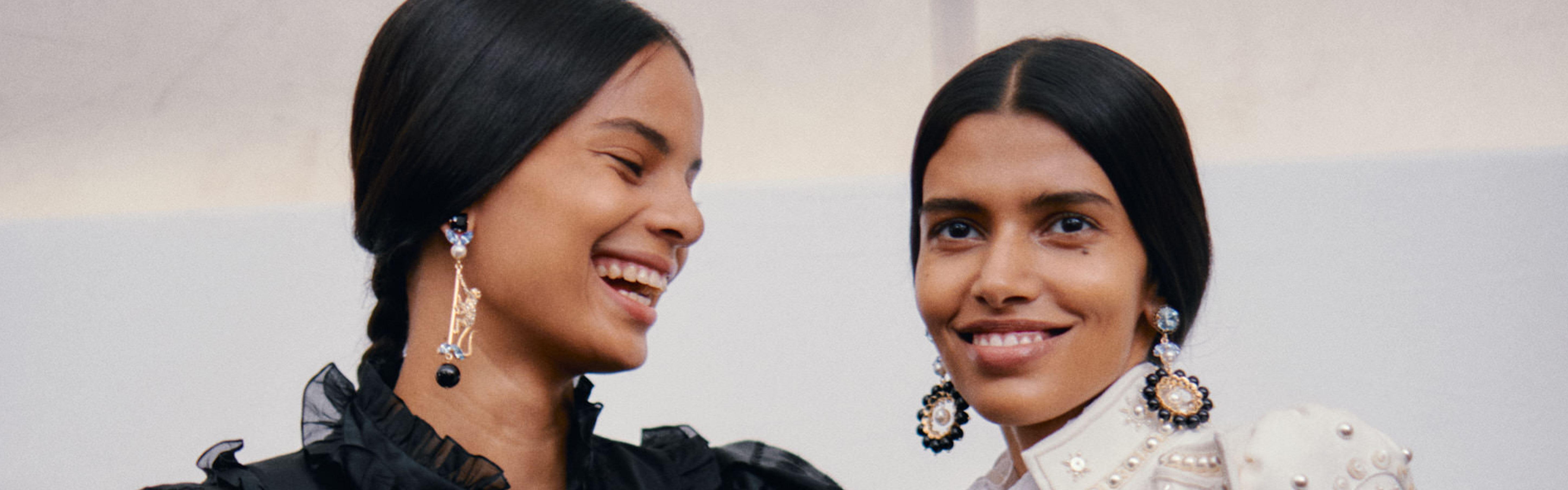 Models in bold, statement earrings from luxury designer ERDEM's beautiful jewellery selection.