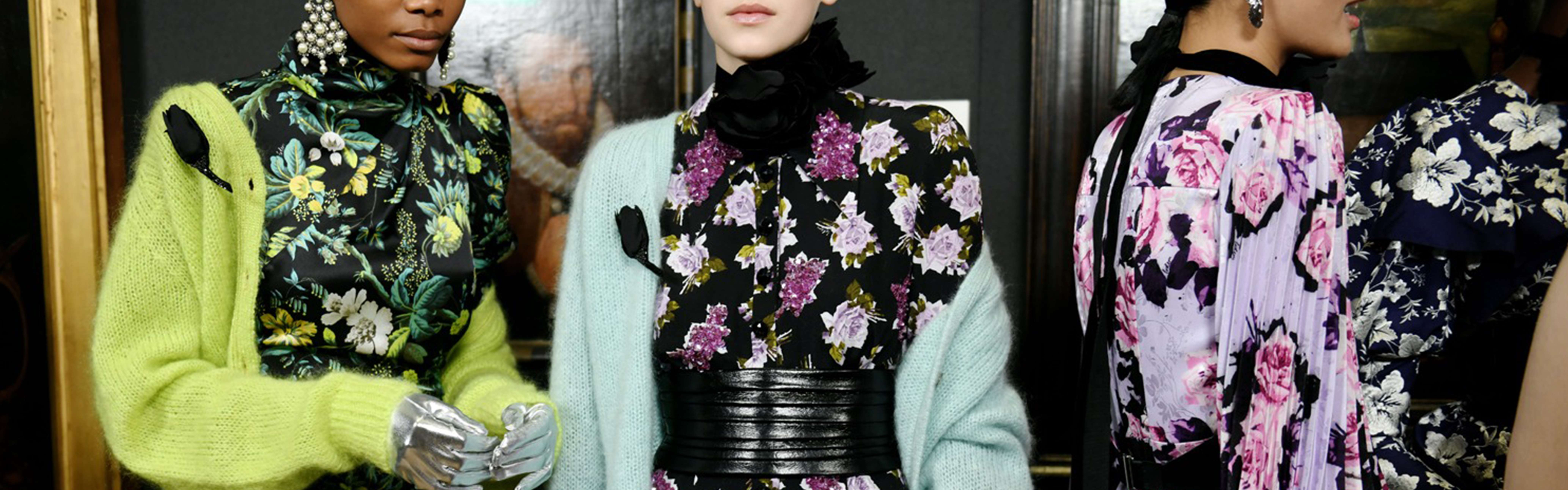 Models in ERDEM luxury floral dresses, powerful and beautiful pieces by the celebrated fashion designer.